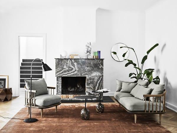 Sala de estar com artigos de decoração Andtradition